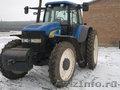 Трактор НЬЮХОЛЛОНД