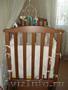 детская кроватка с маятниковым качанием